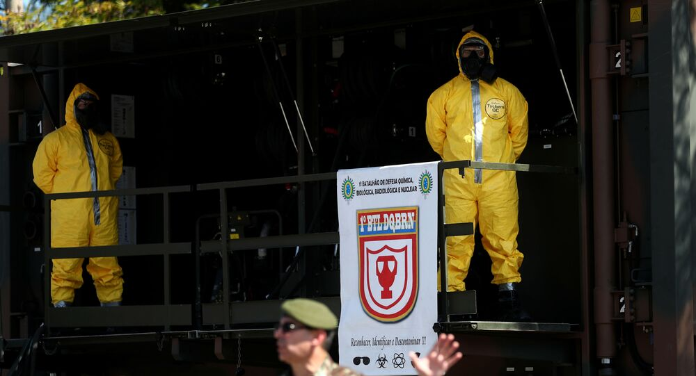 A Brazilian army officer and members of the Biological Radiological and Nuclear Chemical Defense Battalion, demonstrate tactics to combat the new coronavirus pandemic, amid the coronavirus disease (COVID-19) outbreak, at army headquarters in Rio de Janeiro, Brazil April 14, 2020