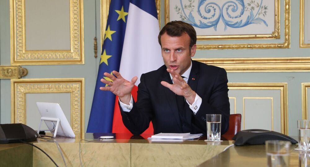 French President Emmanuel Macron takes part in a video conference with World Health Organization (WHO) general director Tedros Adhanom Ghebreyesus at the Elysee Palace in Paris, France April 8, 2020