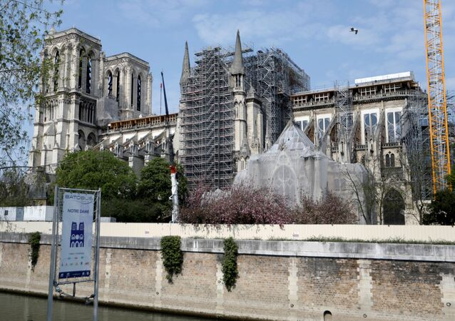 A view shows the Notre-Dame de Paris Cathedral, which was damaged in a devastating fire one year ago, as the coronavirus disease (COVID-19) lockdown slows down its restoration in Paris, France, April 11, 2020