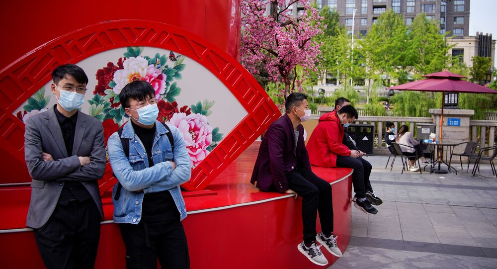 People wearing face masks are seen at a main shopping area after the lockdown was lifted in Wuhan, capital of Hubei province and China's epicentre of the novel coronavirus disease (COVID-19) outbreak, April 14, 2020