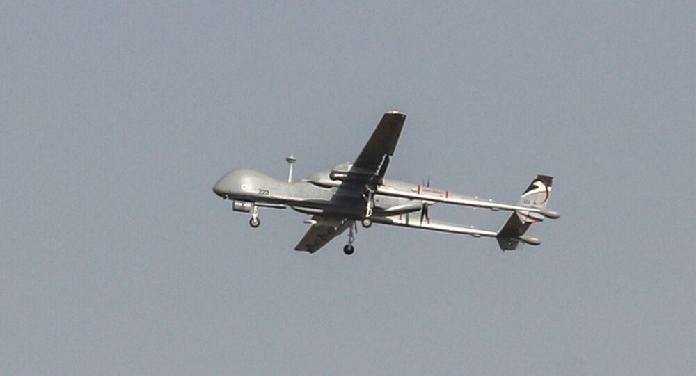 An Israeli Heron military drone flies over the southern Israeli city of Ashdod near the border with Gaza on November 13, 2019