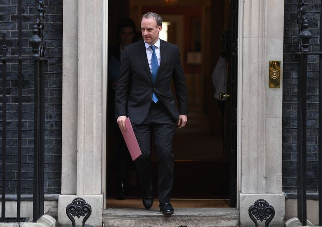 Britain's Foreign Secretary Dominic Raab leaves number 10 Downing street in central London after the daily Covid-19 briefing on April 15, 2020. - The new leader of Britain's opposition Labour Party urged the government today to set out how it plans to end the coronavirus lockdown, both to give people hope and avoid mistakes of the past.