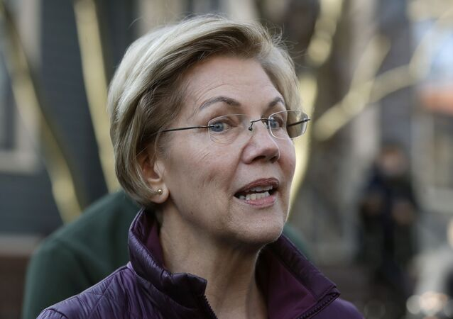 FILE - In this Thursday, March 5, 2020, file photo, Sen. Elizabeth Warren, D-Mass., speaks to the media outside her home in Cambridge, Mass., after she dropped out of the Democratic presidential race
