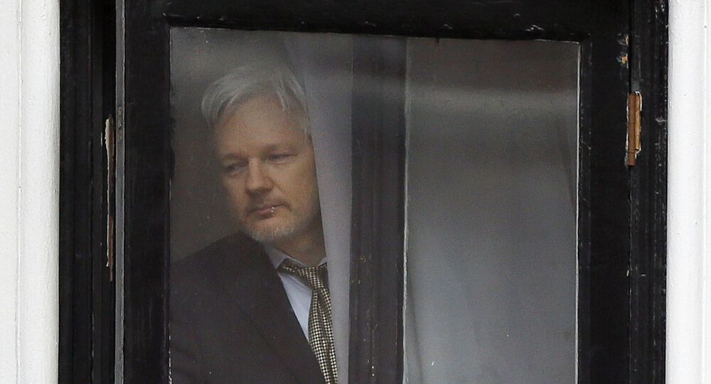 In this Feb. 5, 2016 file photo, Wikileaks founder Julian Assange walks onto the balcony of the Ecuadorean Embassy in London.