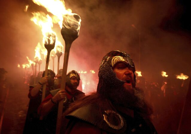 Members of the Jarl Squad in Lerwick, Scotland, on the Shetland Isles, perform the Up Helly Aa Viking festival, Tuesday, Jan. 28, 2020, in Lerwick, Scotland