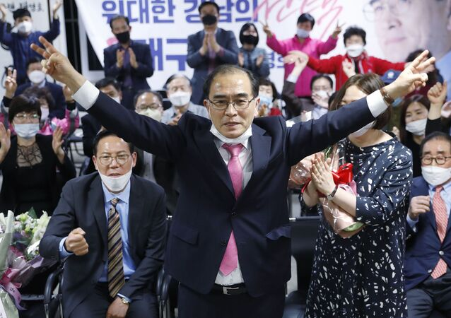 Thae Yong Ho, center, former North Korean diplomat, who defected to South Korea in 2016 and a candidate of the main opposition United Future Party, reacts after he was certain to secure victory in the parliamentary election in Seoul, South Korea, Thursday, April 16, 2020