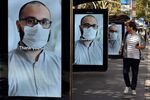A man walks past bus stop advertising boards displaying thank you messages to health workers in response to the COVID-19 coronavirus outbreak, in Sydney on April 15, 2020