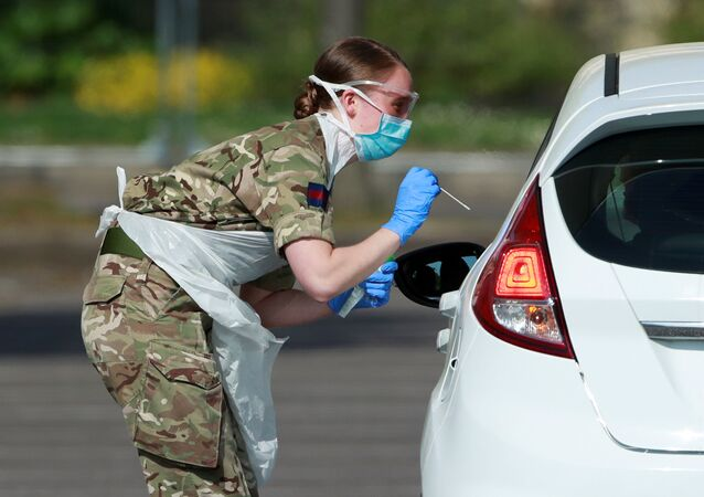 Military personnel are seen testing people at a coronavirus test centre in the car park of Chessington World of Adventures as the spread of the coronavirus disease (COVID-19) continues, Chessington, Britain, April 15, 2020