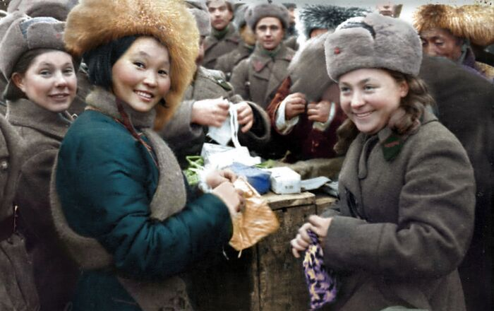 A delegation from Mongolia gives presents to Soviet soldiers.