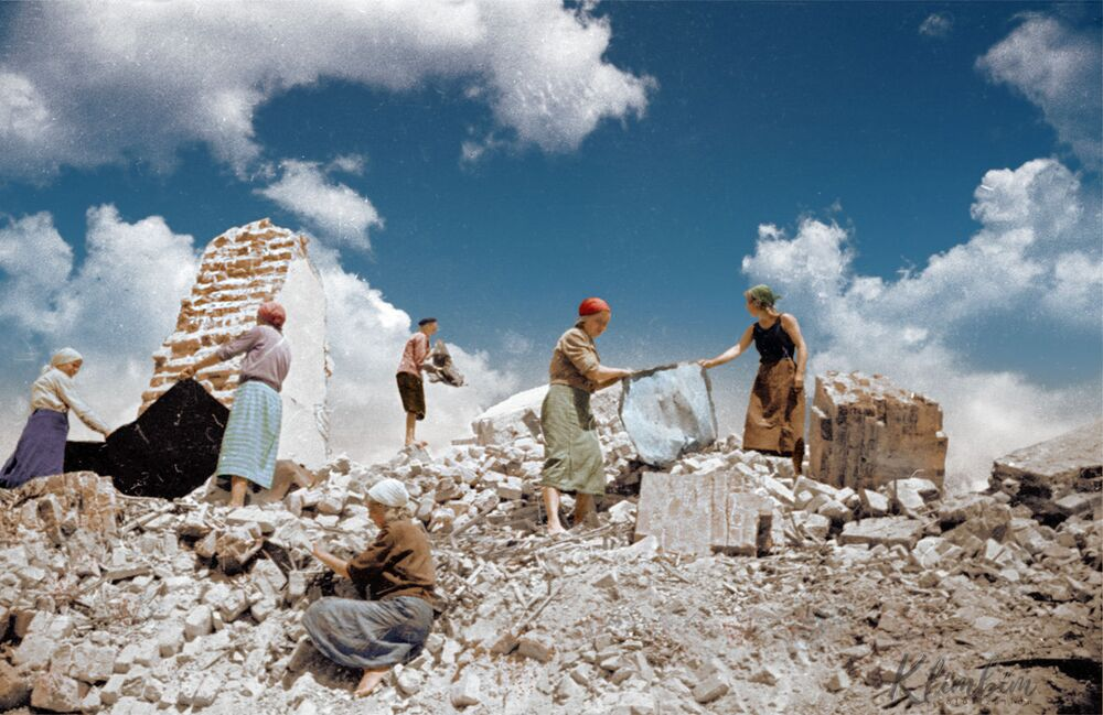 Soviet women removing debris from a building destroyed by bombing.