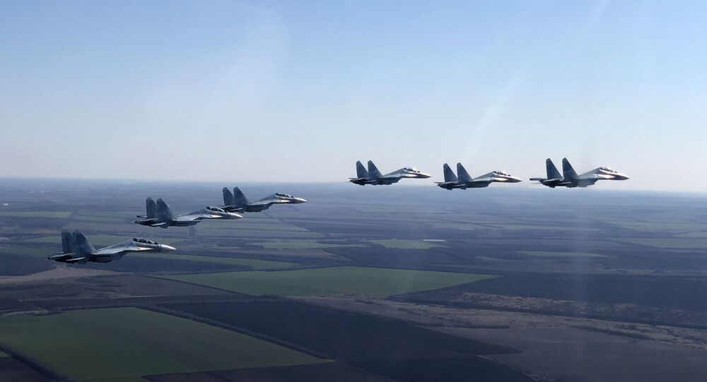 In this handout photo released by the Russian Defence Ministry, Su-30SM jet fighters of the 4th Air and Air Defence Forces Army of the Russian Southern Military District fly in formation during a rehearsal for the Victory Day parade in Rostov-on-Don, which marks the 75th anniversary of the victory over Nazi Germany in World War Two, in Rostov region, Russia