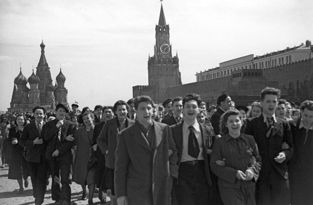 People walk on Red Square during Victory Day celebrations on 9 May 1945