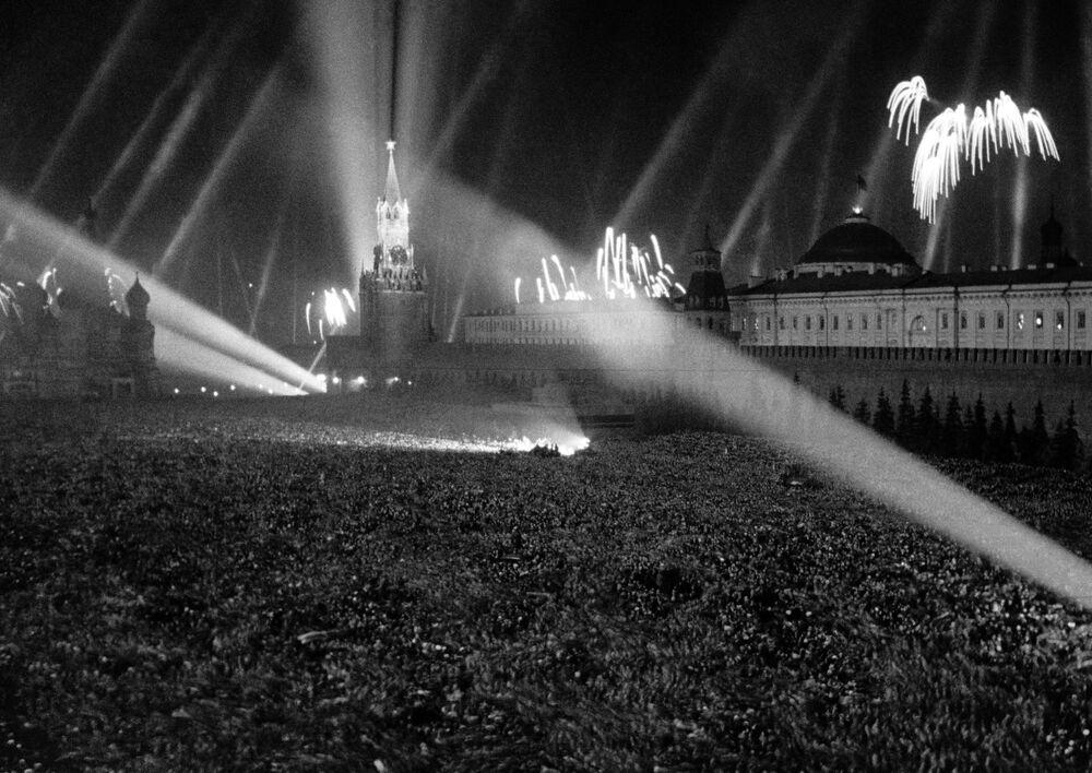 Crowds celebrate Victory Day as salute lights up the sky over Red Square in Moscow on 9 May 1945