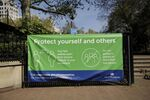 A coronavirus guidelines banner is displayed by an entrance to Victoria Embankment Gardens in London, during the lockdown to try and stop the spread of coronavirus, Wednesday, 15 April 2020.