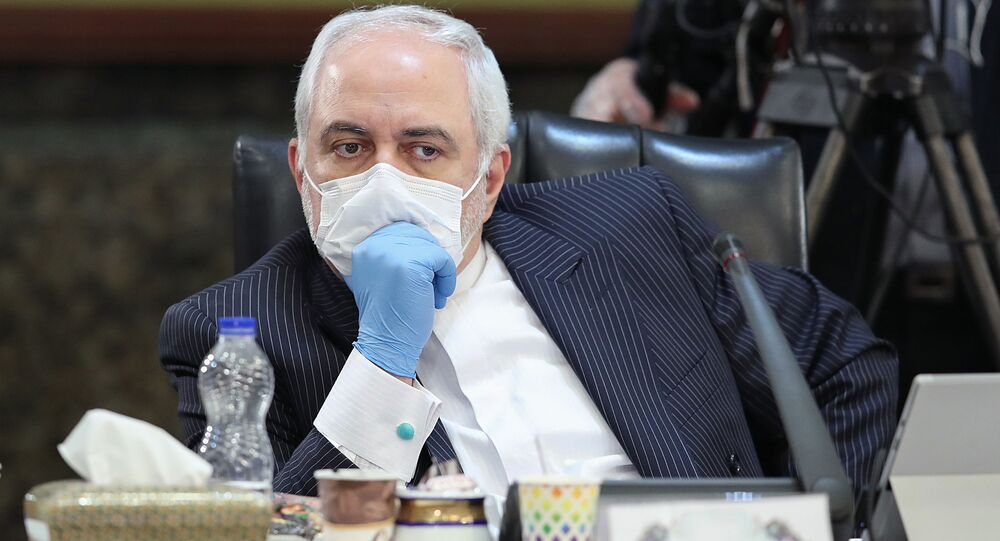 A handout picture provided by the Iranian Presidency on April 15, 2020 shows Iran's Foreign Minister Mohammad Javad Zarif wearing a face mask during a cabinet session in the capital Tehran