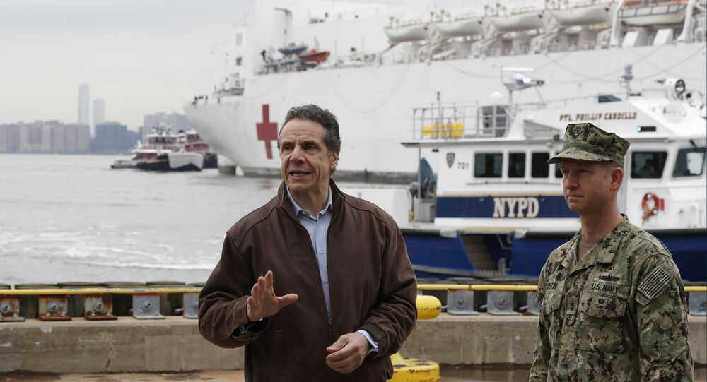 New York Governor Andrew Cuomo stands beside Rear Admiral John B. Mustin as USNS Comfort, a naval hospital ship, docks in New York.