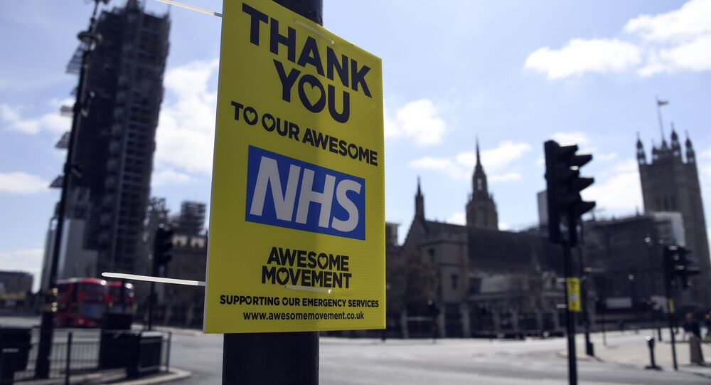 A message in support to the NHS is seen in Westminster, during to the Coronavirus outbreak, in London, Tuesday, April 14, 2020