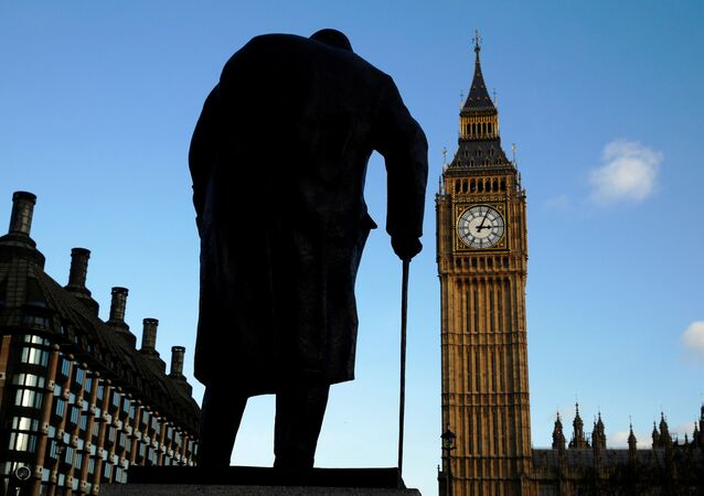 FILE PHOTO: The statue of Britain's former Prime Minister Winston Churchill is silhouetted in front of the Houses of Parliament in London January 24, 2015