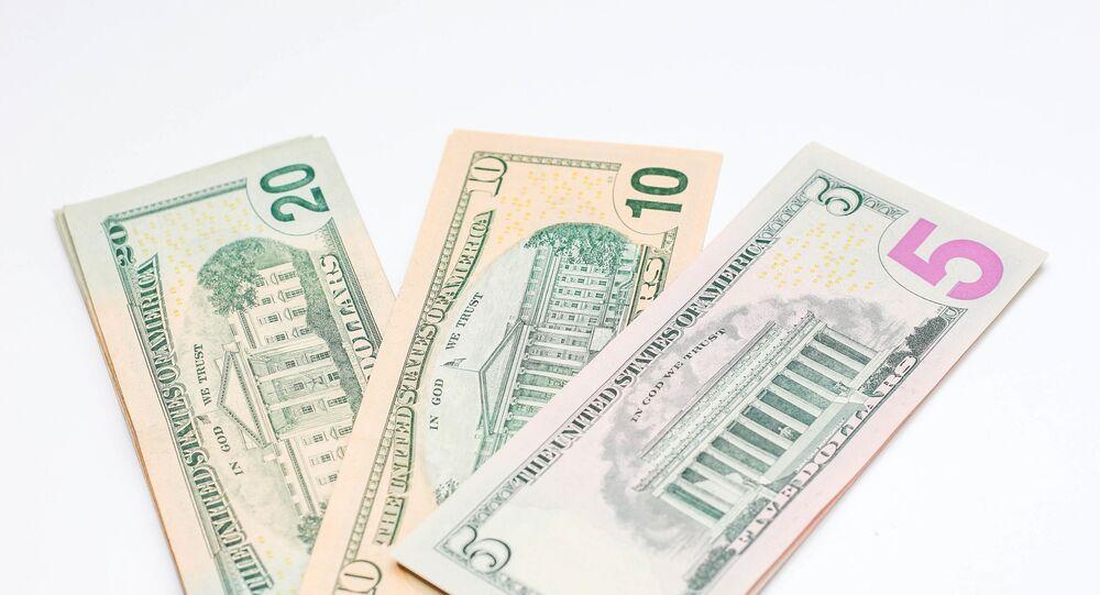 US dollar banknotes on white background.