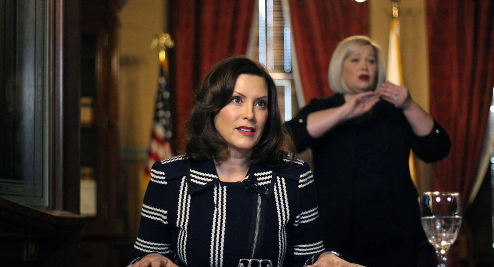 In this photo provided by the Michigan Office of the Governor, Michigan Gov. Gretchen Whitmer addresses the state during a speech in Lansing, Mich., Thursday, April 2, 2020