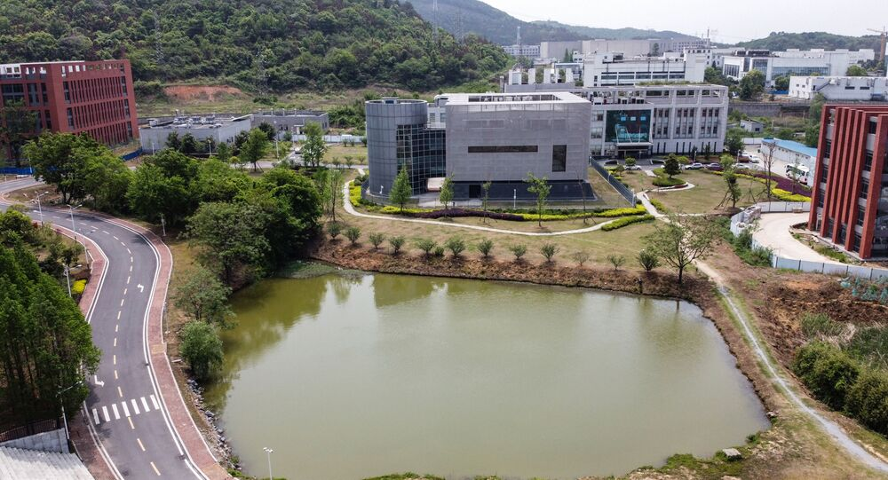 An aerial view shows the P4 laboratory (C) at the Wuhan Institute of Virology in Wuhan in China's central Hubei province on 17 April 2020. - The P4 epidemiological laboratory was built in co-operation with French bio-industrial firm Institut Merieux and the Chinese Academy of Sciences. The facility is among a handful of labs around the world cleared to handle Class 4 pathogens (P4) - dangerous viruses that pose a high risk of person-to-person transmission