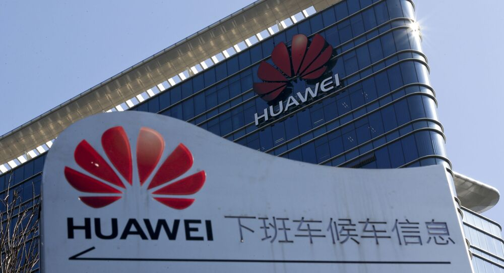 FILE - This Tuesday, Dec. 18, 2018 file photo, shows the Huawei office building at its research and development centre at Dongguan in south China's Guangdong province