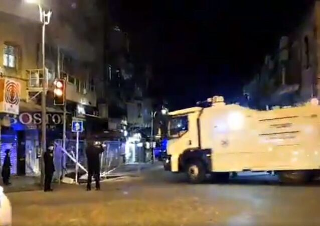 Police forces entering Mea Shearim with a skunk water cannon