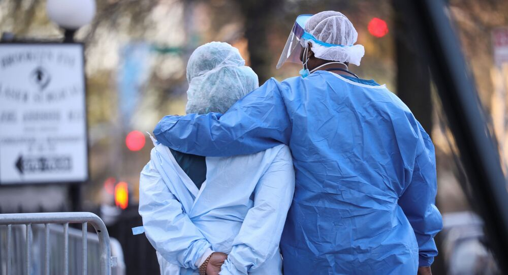 Medical workers walk during a short break at Maimonides Medical Center during the outbreak of the coronavirus disease (COVID19) in the Brooklyn borough of New York, U.S., April 16, 2020. Picture taken April 16, 2020