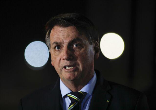 Brazil's President Jair Bolsonaro delivers a  press conference at Palacio da Alvorada da presidencial residence, in Brasilia, on April 16, 2020.