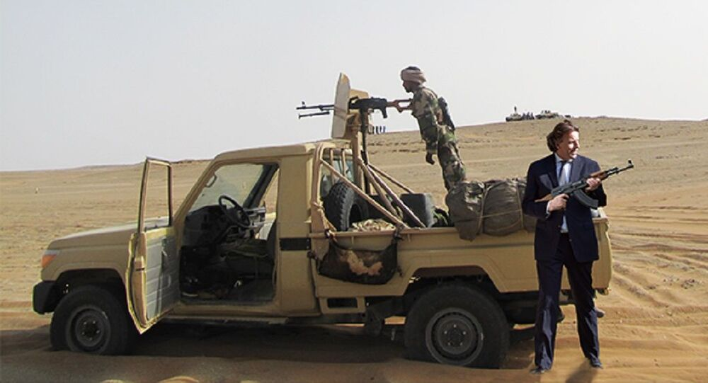 A photo of a pickup truck as delivered by the Netherlands to armed groups in Syria, with photoshopped in it former Dutch minister Bert Koenders of Foreign Affairs who initiated the support to the groups