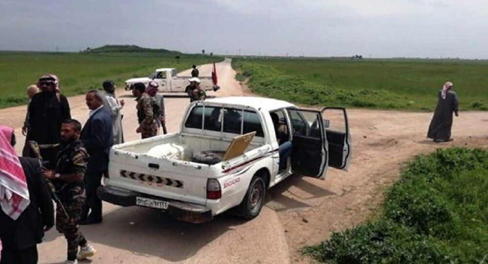 Village residents and Syrian Army troops set up roadblock to prevent US convoy from passing in Al-Hasakah governorate.