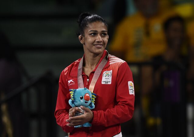 India's silver medallist Babita Kumari Phogat poses for photo during the medal ceremony of the women's freestyle 53kg wrestling event at the 2018 Gold Coast Commonwealth Games in the Carrara Sports Arena on the Gold Coast on April 12, 2018