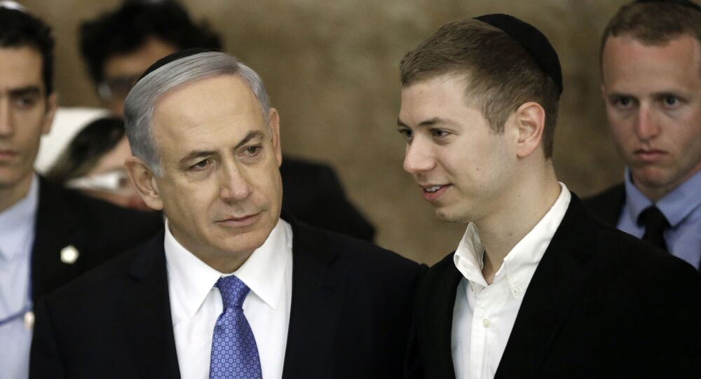 Israeli Prime Minister Benjamin Netanyahu (L) and his son Yair visit, on March 18, 2015, the Wailing Wall in Jerusalem following his party Likud's victory in Israel's general election