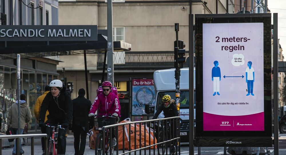 An advertisement of the healthcare services of Sweden instructs people to follow the 2 meters rule to reduce the risk of getting sick, in Stockholm on April 14, 2020.