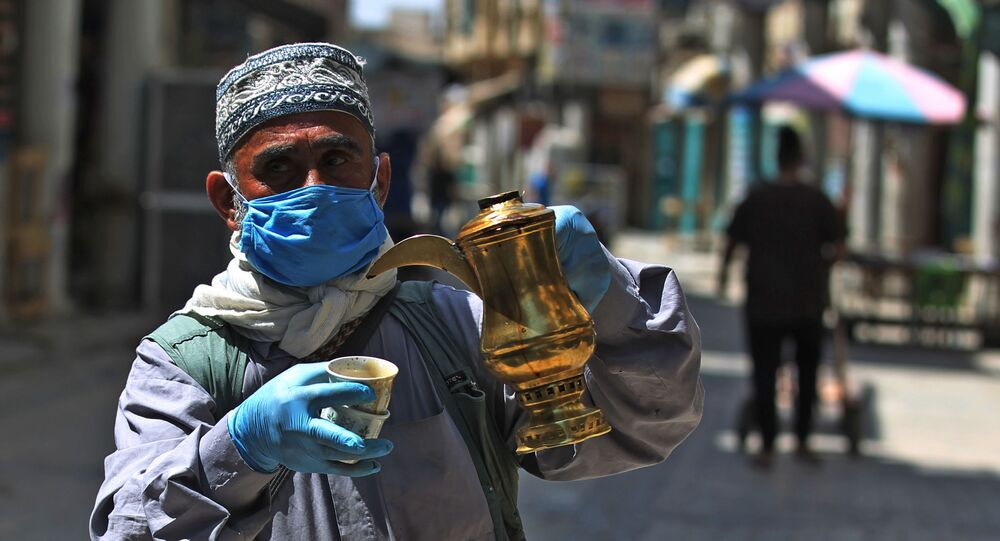 An Iraqi man sells coffee in the capital Baghdad's now deserted al-Mutanabbi street on April 17, 2020, known for its book sellers, during the novel coronavirus pandemic crisis that urged authorities to shut down social gathering places in a bid to slow its spread among the population.