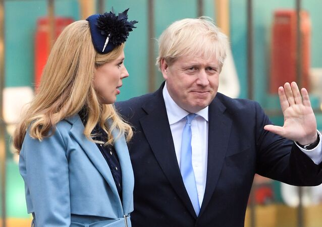 Britain's Prime Minister Boris Johnson and his partner Carrie Symonds leave after the annual Commonwealth Service at Westminster Abbey in London, Britain March 9, 2020