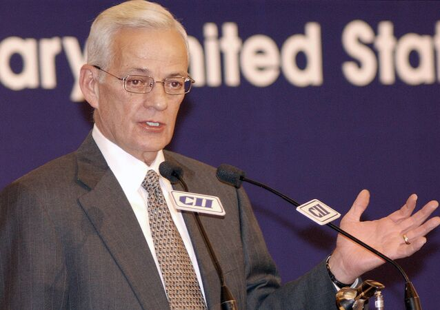 US Treasury Secretary Paul O'Neill gestures as he addresses a CII luncheon in New Delhi, 22 November 2002.