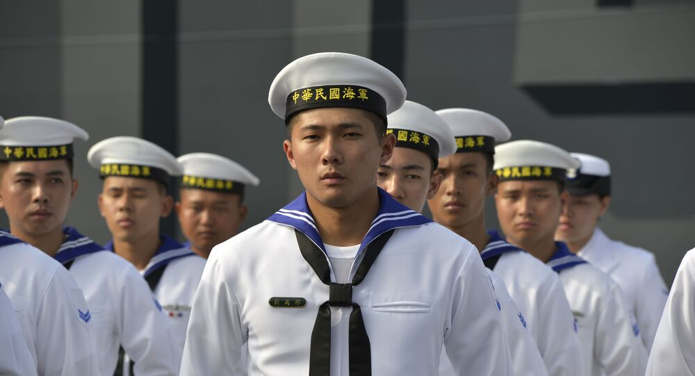 Taiwan sailors parade in front of a new frigate during a ceremony to commission two Perry-class guided missile frigates from the US into the Taiwan Navy, in the southern port of Kaohsiung on November 8, 2018.