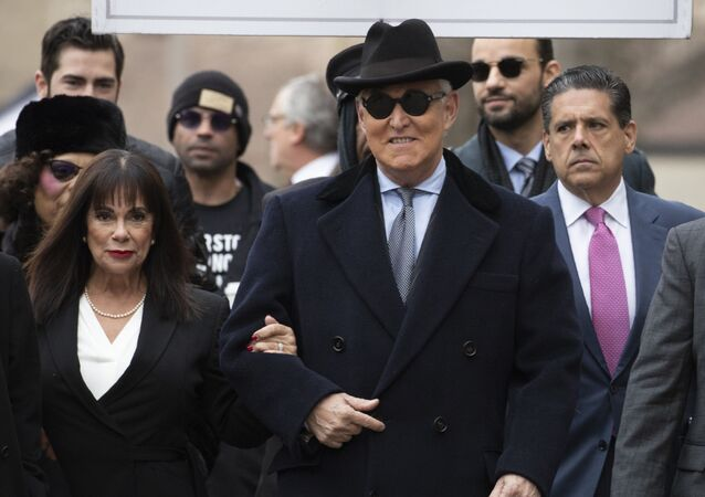 Roger Stone accompanied by his wife Nydia Stone, left, arrives for his sentencing at U.S. District Court in Washington, Thursday, Feb. 20, 2020
