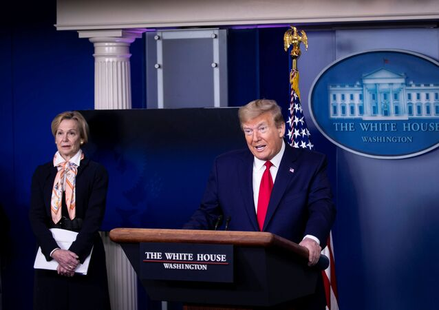 U.S. President Donald Trump speaks at the daily coronavirus task force briefing next to White House Coronavirus Response Coordinator Dr. Deborah Birx in Washington, D.C., U.S., April 18, 2020