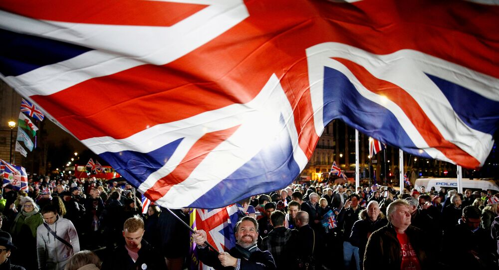 FILE PHOTO: A man waves a British flag on Brexit day in London, Britain January 31, 2020.