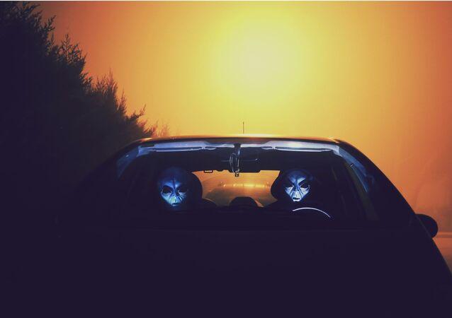 Two Alien Inside Car