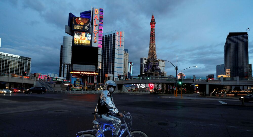 A man stands on his bicycle  on the Las Vegas strip as the spread of coronavirus disease (COVID-19) continues, in Las Vegas, Nevada U.S., April 10, 2020.