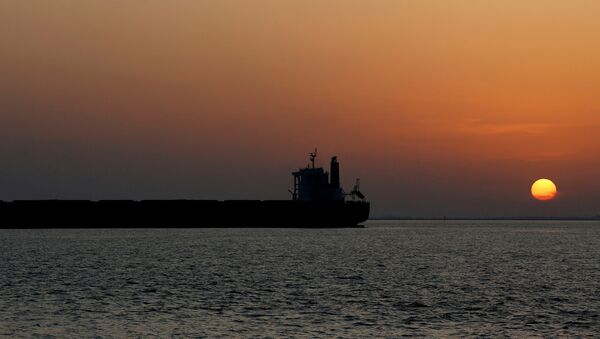 An oil tanker sits anchored off the Fos-Lavera oil hub near Marseille, France, September 17 - Sputnik International