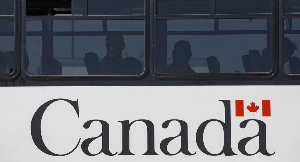 Members of the Canadian Forces wait on a bus to convoy to CFB Borden amid the spread of the coronavirus disease (COVID-19) on April 6, 2020 in Toronto, Canada.