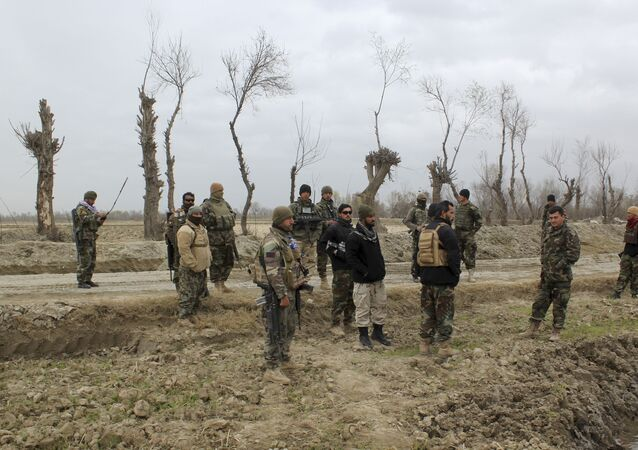 Afghan security forces stand guard after an attack by Taliban militants near an Afghan National Army (ANA) outpost, in Kunduz Province on March 4, 2020.