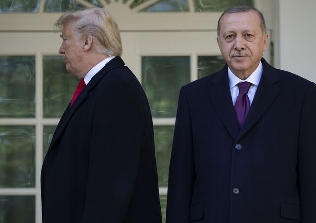 President Donald Trump walks off toward the Oval Office after posing for photographers with Turkish President Recep Tayyip Erdogan before a meeting in the Oval Office of the White House, Wednesday, Nov. 13, 2019, in Washington