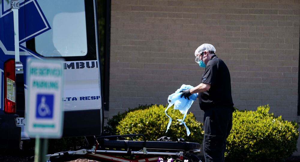 An ambulance worker is seen outside the Canterbury Rehabilitation & Healthcare Center in Richmond, Virginia, U.S., April 16, 2020