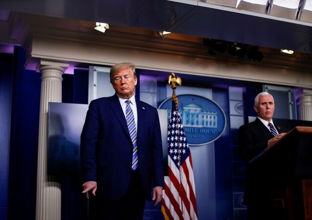 U.S. President Donald Trump signals FDA Commissioner Dr. Stephen Hahn (not pictured) as U.S. Vice President Mike Pence speaks during the daily coronavirus task force briefing at the White House in Washington, U.S., April 19, 2020