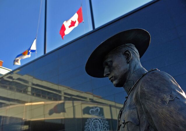 Flags of Nova Scotia and Canada fly at half-mast outside the Royal Canadian Mounted Police headquarters in Dartmouth.